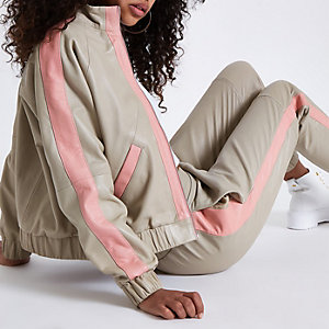 Beige leather long sleeve bomber jacket