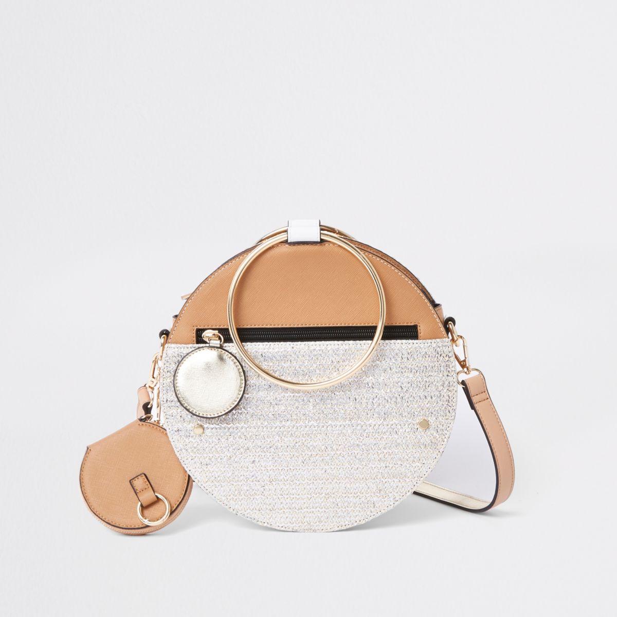 Beige gold tone handle round cross body bag