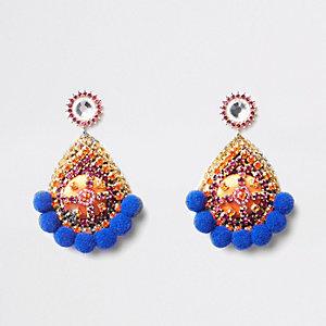 Blauwe oorknopjes met pompon en diamantjes