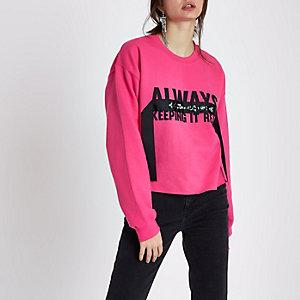 Roze sweatshirt met 'keeping it real'-print en sierstenen