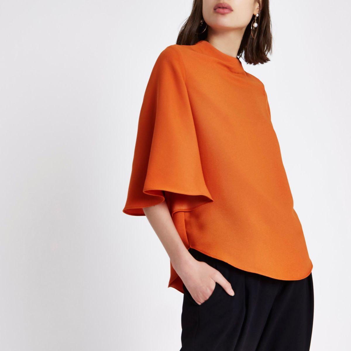 Orange cape sleeve top