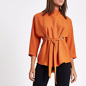 Orange eyelet tie front high neck top