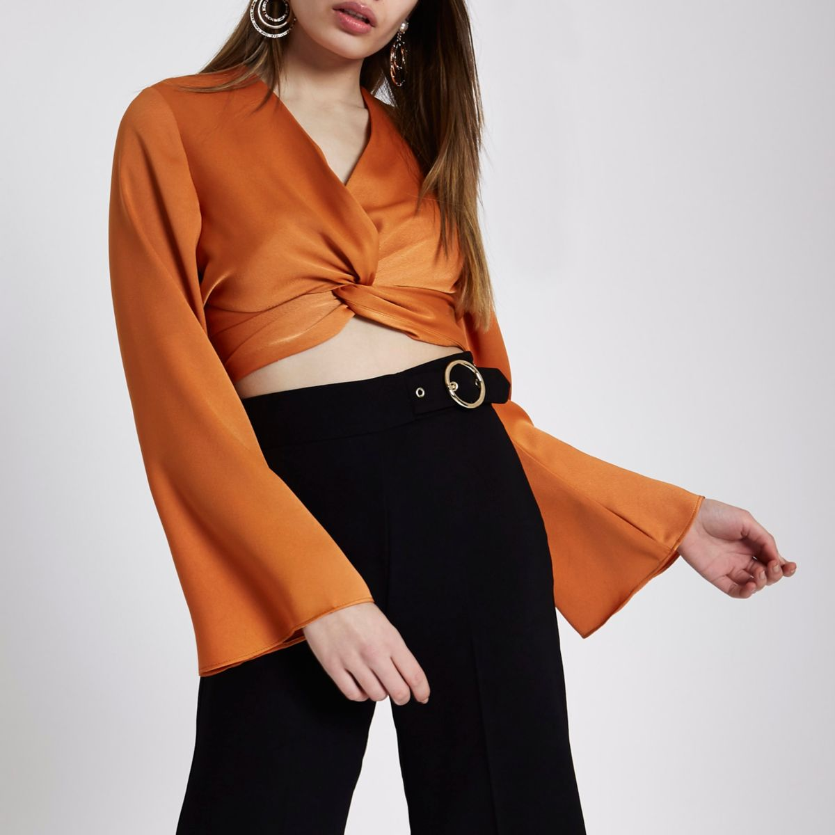 Orange long sleeve twist front crop top