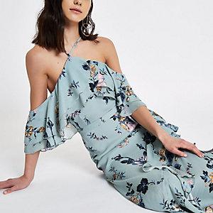 Robe longue à fleurs bleue avec épaules dénudées et volant