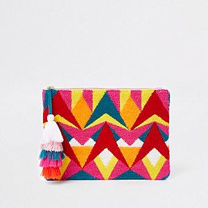 Pochette rose à motif géométrique multicolore et pampilles