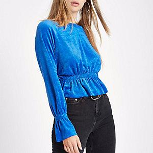 Top en tissu éponge bleu à manches longues et ourlet plissé