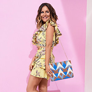 Blue Caroline Flack print towel clutch bag