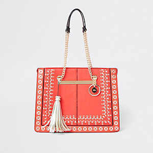 Red lasercut chain handle tote bag