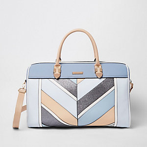 Blaue, gestreifte Reisetasche mit Glitzer