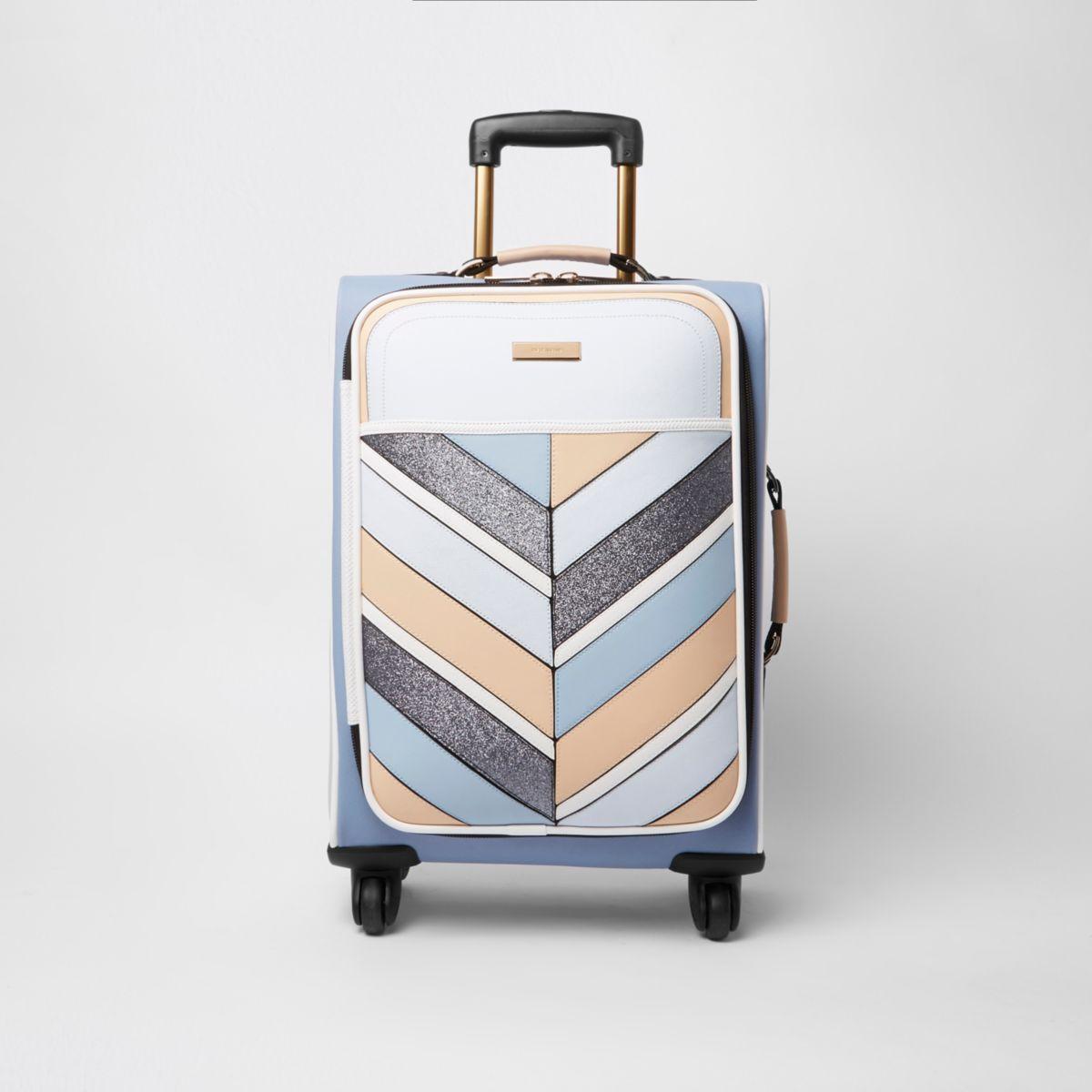 Blauwe gestreepte koffer met vier wielen en glitter