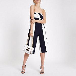Combinaison jupe-culotte rayée bleu marine à encolure Bardot