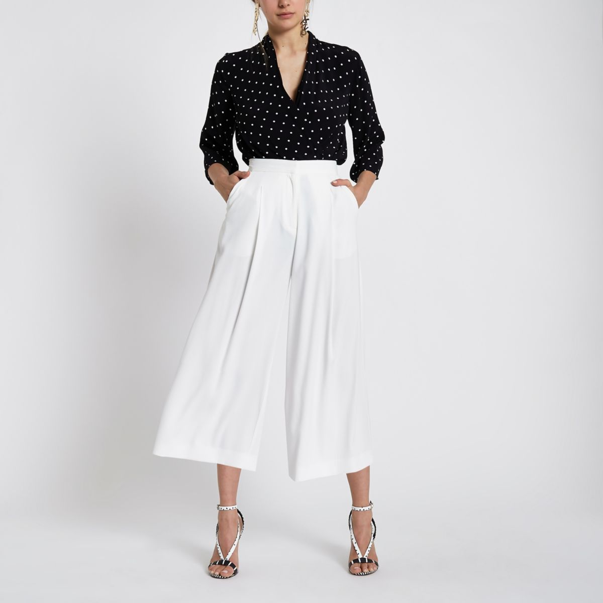 Black polka dot bodysuit top