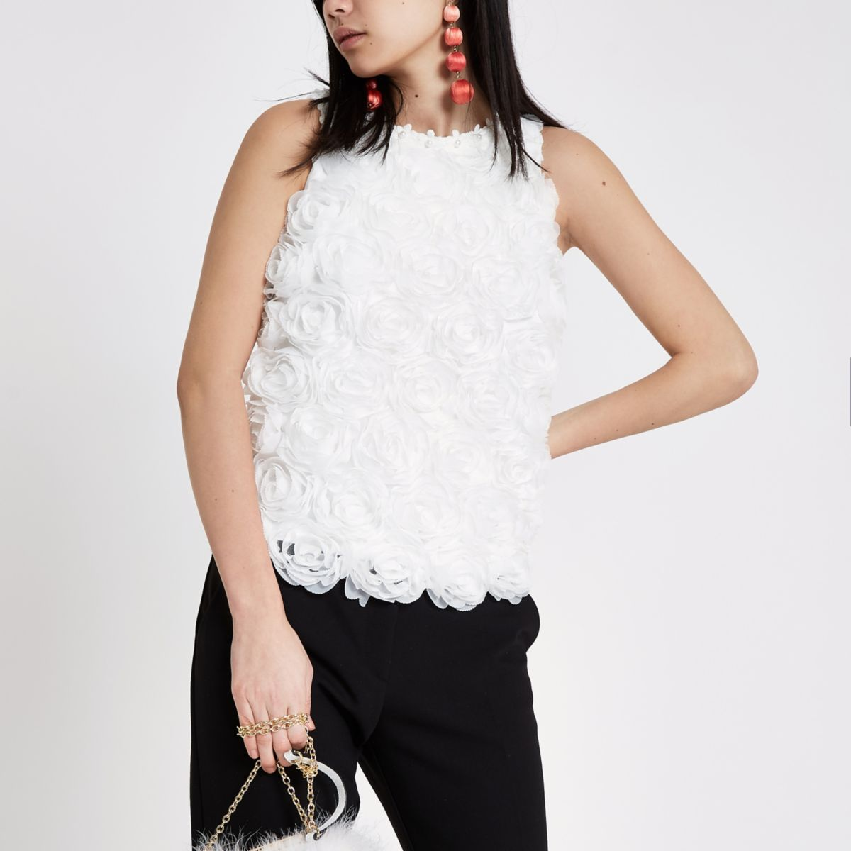 White floral sleeveless fitted top