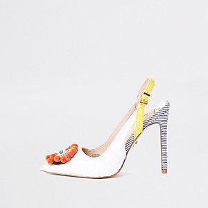 White pom pom embellished court shoes