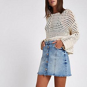Mini-jupe trapèze en jean bleu avec boutons