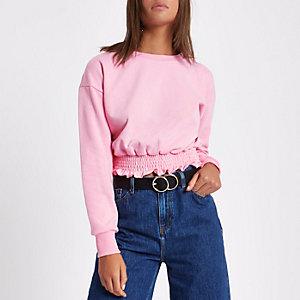 Lichtroze cropped sweatshirt met gesmokte zoom