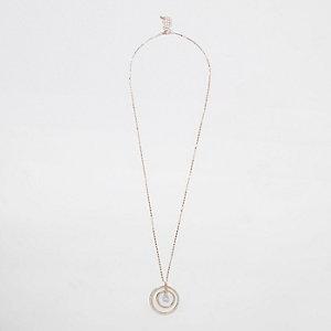 Goudkleurige ketting met cirkel en vierkante zirconia