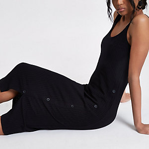 Black asymmetric button bodycon dress