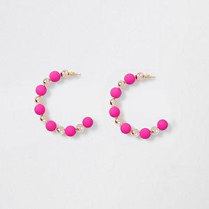 Pink rubberised ball hoop earrings