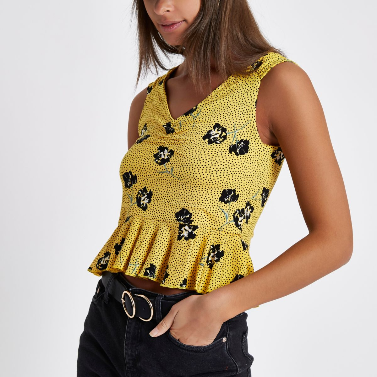 Yellow floral sleeveless peplum top