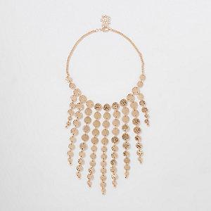 Gold tone coin cascade necklace