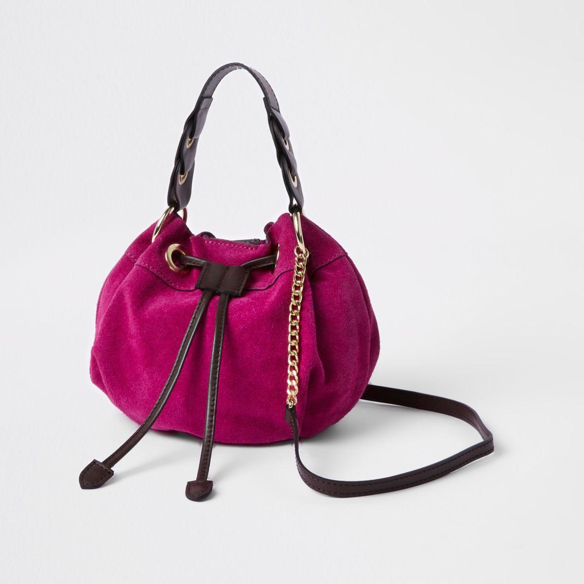 Pink suede mini duffle cross body bag