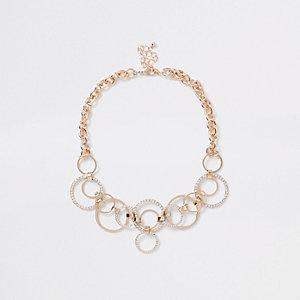 Chaîne dorée tendance avec anneau pavé