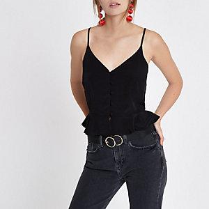 Zwarte cami top met peplum aan de zoom en knoopsluitng voor