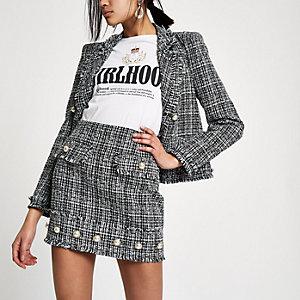 Black boucle faux pearl mini skirt