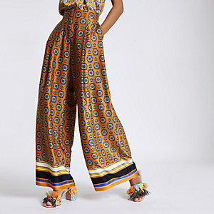 Orange mixed print wide leg trousers
