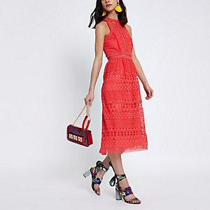 Oranje mouwloze hoogsluitende gehaakte jurk