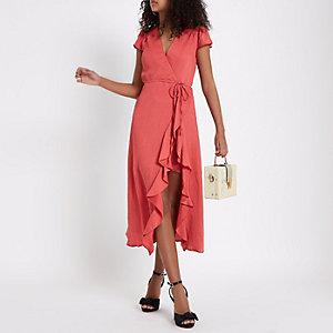 Roze midi-jurk met strikceintuur en ruches
