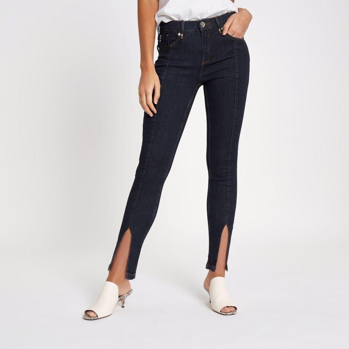 Amelie - Donkere superskinny jeans met split in de zoom
