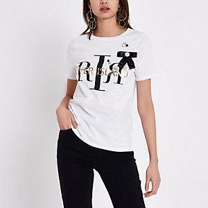 Wit verfraaid T-shirt met RI-logo en strik