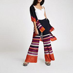 Orange stripe knit flare pants