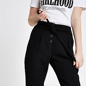 Black button front tapered peg trousers