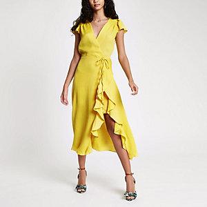 Gele midi-jurk met ruches en strikceintuur