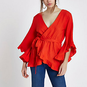Red wrap front frill tie waist top