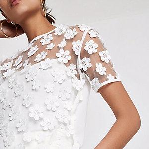 Crème T-shirt met mesh en bloemen
