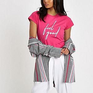 Roze aansluitend T-shirt met 'feel good'-print