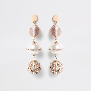 Pink rhinestone wrapped globe drop earrings