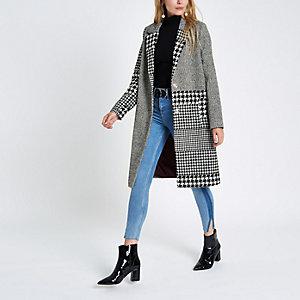 Zwarte wollen jas met ruitenmix