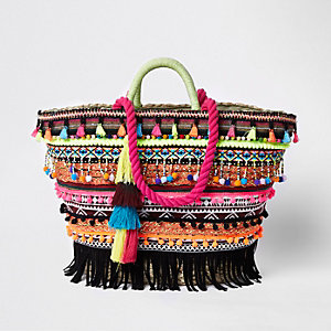 Pink tassel woven basket shopper bag