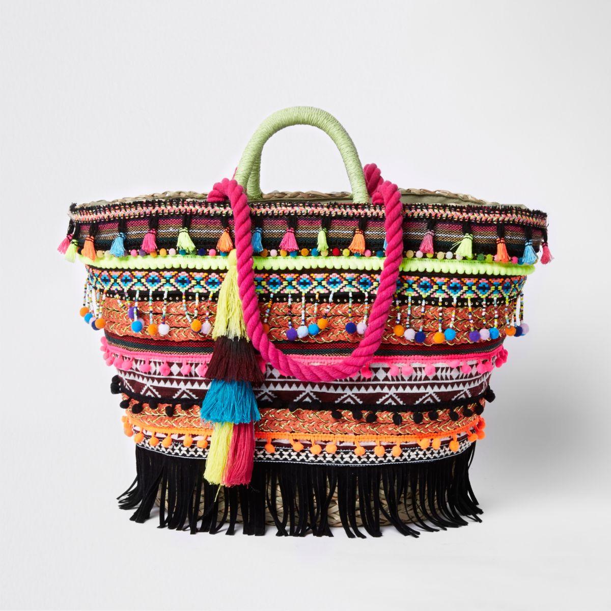 Pink tassel woven basket shopper bag