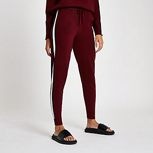 Red 'winging it' knitted joggers