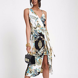 Gele midi-jurk met blote schouder en sjaalprint