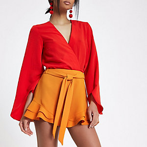 Orange frill hem tie waist shorts