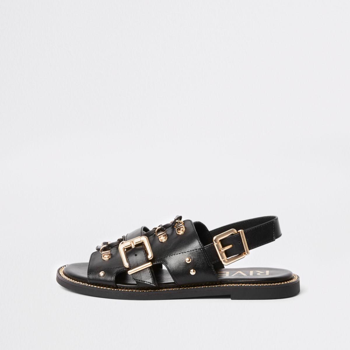 Zwarte platte sandalen met bandjes en en gesp