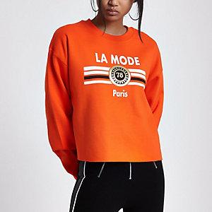 Oranje sweatshirt met 'La mode'-print