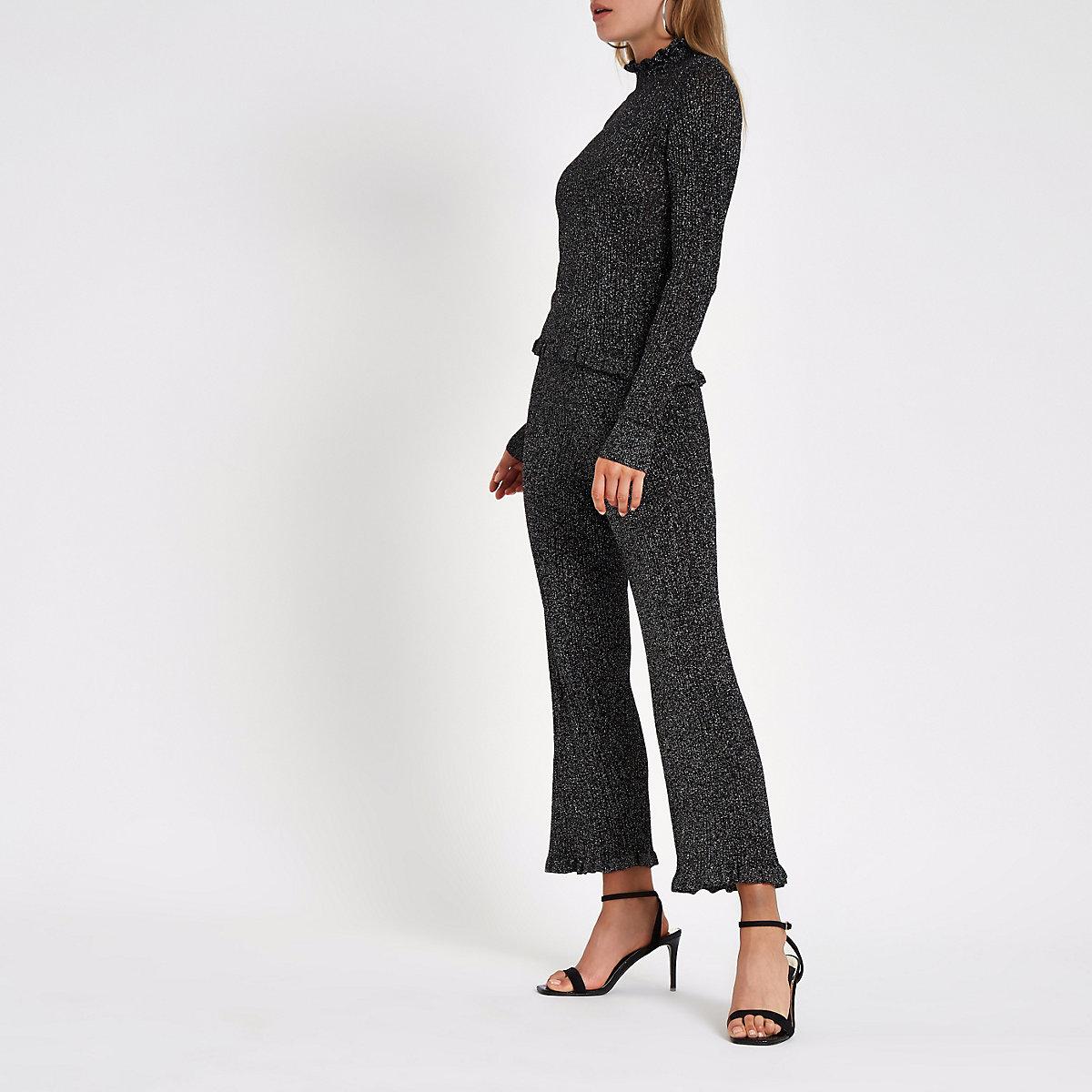 Black metallic knit frill hem trousers